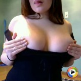 Kayla plays with her big juicy tits