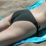 Girls ass in a bikini at the beach