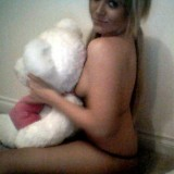 Monroe gets naked with her teddy bear