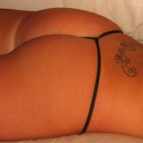 Chrissy shows off her cute tight ass in a tiny black g-string